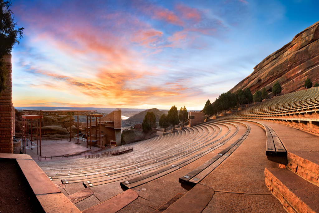 Things to do in Denver, photo of empty red rocks amphitheater with sunset