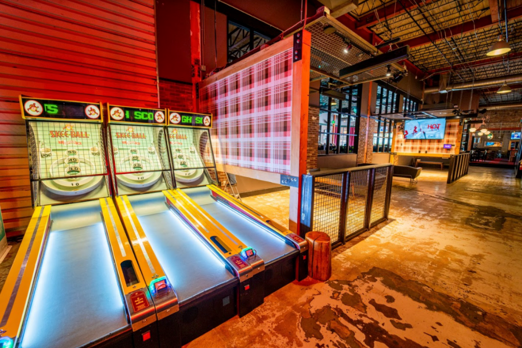 Things to do in Denver, photo of 3 skeeball game machines inside punchbowl social